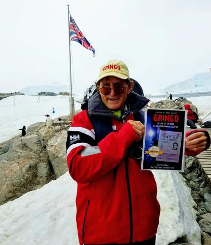 About to do GRINGO book signing in Penguin colony in Anartctica. Gringo cap, British Flag