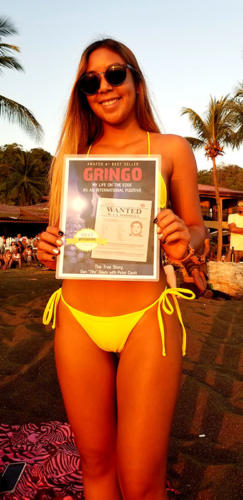 Young lady on Costa Rica beach with GRINGO book cover
