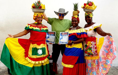 Dan Tito Davis with colorfully dressed women in the streets of Cartagena, Colombia