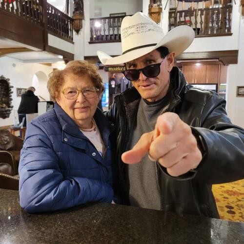 Checking into the Hotel Alex Johnson, Rapid City, South Dakota, with his 91 year old mother Marcelleen Davis, May 2021